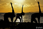 Photographing a picturesque sunset at Magic Island Oahu, a yoga group came in front of my location and practiced yoga.