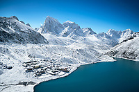 The guesthouses at Gokyo alongside a lake in fresh snow, Nepal