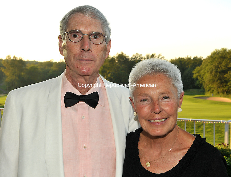 HARWINTON, CT, 20 AUGUST 2011-082011JS09-- Brian Lenoci of Madison, Conn. and his wife Cookie Lenoci  at the American Cancer Society Hope Under the Stars gala held Saturday August 20, 2011 at Fairview Farms Golf Course in Harwinton. <br /> Jim Shannon Republican-American