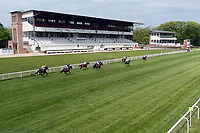 10.05.2020, Hoppegarten, Brandenburg, Germany;  Horses and jockeys in front of the empty grandstands due to corona pandemic