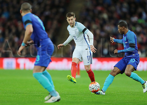 29.03.2016. Wembley Stadium, London, England.  International Football Friendly England versus Netherlands. England Midfielder Adam Lallana knocks the ball past Netherlands Midfielder Georginio Wijnaldum