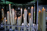 Burning candles dedicated to the Virgin Mary, Lourdes, France.