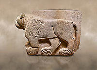 """Hittite relief sculpted stone panel. Lion. Aslantepe Gate Limestone, Aslantepe, Malatya, 1200-700 B.C. Anatolian Civilisations Museum, Ankara, Turkey.<br /> The lion on the left of the two lions at the gate of the palace. His head and his front part were processed as high embossing and his body as regular embossing. The signs behind the lion and over his tail read; """"Halposulupis, Mighty (?) King"""".<br /> <br /> Against a brown art background."""