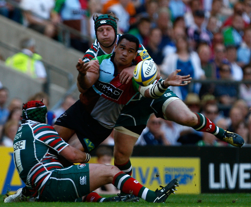 Photo: Richard Lane/Richard Lane Photography. Harlequins v Leicester Tigers. Aviva Premiership Final. 26/05/2012. Quins' James Johnson offloads the ball as he is tackled by Tigers' Thomas Waldrom.