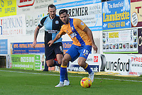 Mansfield Town's Ryan Tafazolli being tracked by Wycombe Wanderers captain Paul Hayes during the Sky Bet League 2 match between Mansfield Town and Wycombe Wanderers at the One Call Stadium, Mansfield, England on 31 October 2015. Photo by Garry Griffiths.