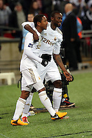 Pictured: Jonathan de Guzman (L), Roland Lamah (R). Sunday 24 February 2013<br /> Re: Capital One Cup football final, Swansea v Bradford at the Wembley Stadium in London.