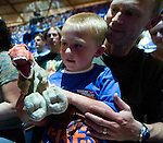 Five-year-old Scott, held by his father Steve Brewer, plays with a stuffed T-Rex while attending Walking with Dinosaurs at the Tacoma Dome in Tacoma, Washington on July, 11, 2007.  The 90- minute show,  based on the award-winning BBC Television series kicked off it's seven city tour in the U.S. and Canada. 15 dinosaurs, which roamed the earth about 208 million years ago, have been brought back to life via truck batteries, hydraulics and puppeteers in the 90-minute show, Walking with Dinosaurs - The Live Experience, based on the award-winning BBC Television series kicked off it's seven city Summer tour in the U.S. and Canada.  (© 2007 Jim Bryant Photography)..