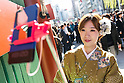 A Chinese tourist dressed in traditional Japanese kimono poses for a selfie at the entrance of Sensoji temple in Asakusa district on January 22, 2016, Tokyo, Japan. The Japan National Tourism Organization reported on Tuesday 19th a record increase in foreign visitors in 2015. Approximately 19.73 million people visited Japan from abroad, up 47.3 percent. According to the report there were more Chinese visitors than from any other nation with 4.99 million coming in 2015. South Korea (4 million) and Taiwan (3.67 million) were next on the list, and over 1 million Americans also visited Japan in 2015. The number of visitors is the highest in 45 years and already close to Japan's goal of attracting 20 million foreign visitors in a year by 2020. (Photo by Rodrigo Reyes Marin/AFLO)