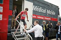 Greg Henderson (NZL/Lotto-Belisol) leaving the post-race medical vehicle on 1 leg. A deep cut on his already plagued knee forced him to abandon mid-stage.<br /> <br /> 2014 Tour de France<br /> stage 4: Le Touquet-Paris-Plage/Lille Métropole (163km)
