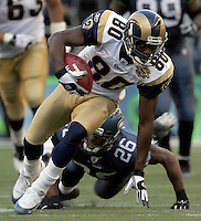 St.Louis Rams wide receiver #80 Isaac Bruce keeps his balance after making a 27-yard reception late in the game on a scoring drive. Rams came from behind winning the game over the Seahawks at Qwest Field in Seattle Sunday October 7, 2004.