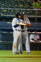 Tennessee Smokies second baseman Ronald Torreyes #2 talks with manager Buddy Bailey #26 during a game against the Huntsville Stars on April 16, 2013 at Joe W Davis Municipal Stadium in Huntsville, Alabama.  Tennessee defeated Huntsville 4-3.  (Mike Janes/Four Seam Images)