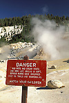 Danger warning sign next to hydrothermal hot spirng at Bumpass Hell, Lassen Volcaninc National Park, California