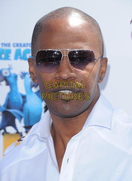 "JAMIE FOXX .at The Twentieth Century Fox and Blue Sky Studios L.A. Premiere of ""RIO"" held at The Grauman's Chinese Theatre in Los Angeles, California, USA, .April 10th 2011..portrait headshot  white shirt sunglasses                                                                   moustache facial hair mustache soul patch .CAP/RKE/DVS.©DVS/RockinExposures/Capital Pictures."