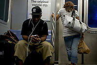 Subway riders, street photography in NY August 3, 2007