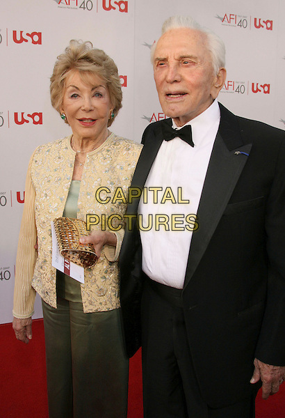 ANNE & KIRK DOUGLAS.35th AFI Life Achievement Award Honoring Al Pacino held at the Kodak Theatre, Hollywood, California, USA..June 7th, 2007.half length tuxedo jacket bow tie gold clutch purse yellow floral embroidered married husband wife .CAP/ADM/RE.©Russ Elliot/AdMedia/Capital Pictures