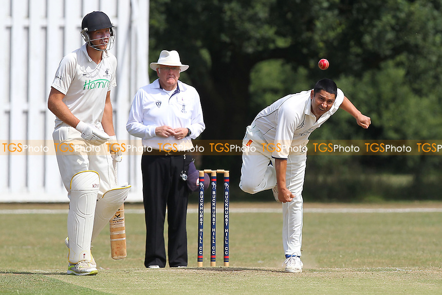 S Saeed in bowling action for Wanstead - Buckhurst Hill CC vs Wanstead CC - Essex Cricket League at Roding Lane - 27/07/13 - MANDATORY CREDIT: Gavin Ellis/TGSPHOTO - Self billing applies where appropriate - 0845 094 6026 - contact@tgsphoto.co.uk - NO UNPAID USE