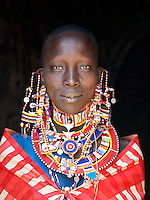 Maasai tribeswoman in traditional clothing, near Amboseli National Park, Rift Valley Province, Kenya