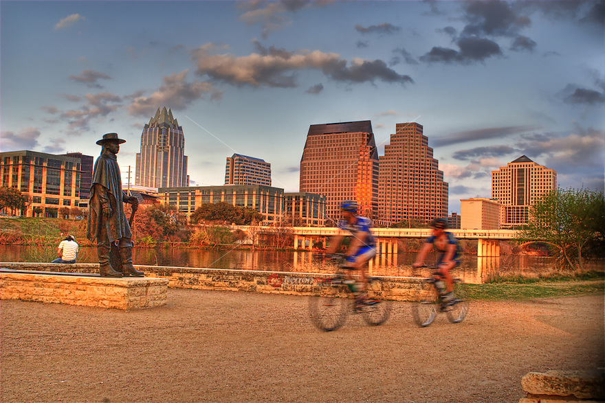 Bikers enjoy beautful day on hike and bike trail near Stevie Ray Vaughan Memorial on Town Lake in Austin, Texas, USA