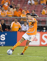 Houston Dynamo midfielder Geoff Cameron (20) crosses the ball.  Houston Dynamo defeated Atlante FC 4-0  during the group stage of the Superliga 2008 tournament at Robertson Stadium in Houston, TX on July 12, 2008.