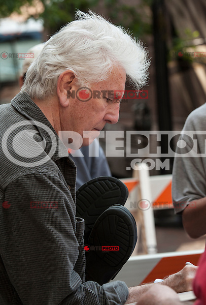Graham Nash signs autographs before a performance at the Boston Wang Theater in Boston, Mass. June 18, 2012. © Rocco S. Coviello/MediaPunch Inc. NORTEPHOTO.COM<br />