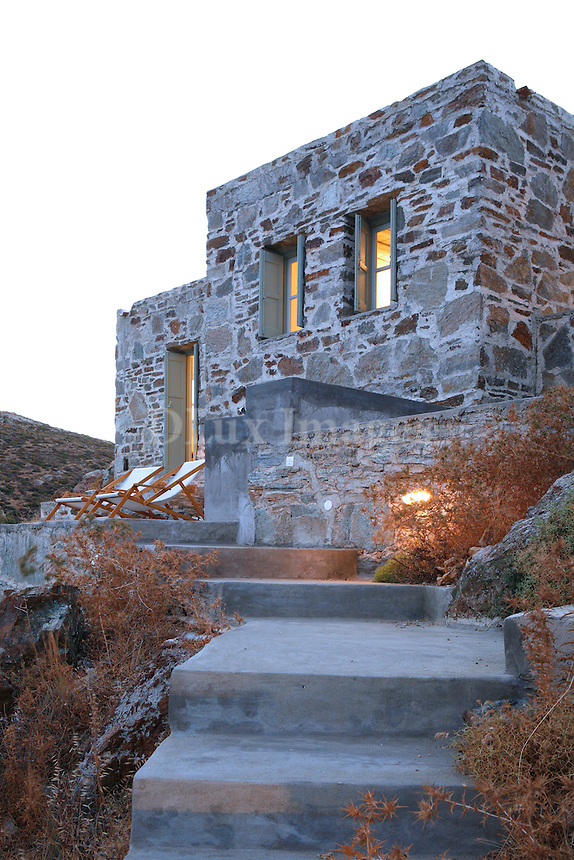 Greek architect George Zafiriou was commissioned to design this house on the island of Serifos by a well know Italian fashion designer.  He created this minimalist masterpiece with stones from the surrounding area, and situated it to take advantage of the breathtaking views of the private beach and sea below.