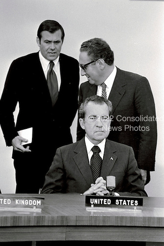Brussels, Belgium - June 26, 1974 -- North Atlantic Council Meeting at the level of Heads of State and Government sign a Declaration on Atlantic Relations approved and published by the Council in Ottawa at North Atlantic Treaty Organization (NATO) Headquarters in Brussels, Belgium on June 26, 1974.  From left to right: United States Ambassador to NATO Donald Rumsfeld, top left; United States Secretary of State Henry A. Kissinger, top right; and United States President Richard M. Nixon, bottom right.<br /> Credit: NATO via CNP