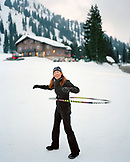 USA, Utah, woman playing in snow hula hooping, Alta Ski Resort