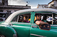 Havana, Cuba, sept 2014.Street scene in Center Havana.        In recent years, Raul Castro has made several economic measures for the people of the island. Cubans can now buy and sell apartments or cars, can stay in hotels on the island and can travel abroad with minor difficulties. Most of the global economists believe that these changes are moving in the right direction but its positive effects on people are very slow. Cubans continue to struggle daily through the streets of Havana with humor and zest for life.                                  En los ultimos años Raul Castro ha realizado varias medidas economicas para el pueblo de la isla. Ahora los cubanos pueden comprar y vender departamentos o coches, pueden alojarse en hoteles de la isla y pueden viajar al extranjero con menores dificultades. La mayor parte de los economistas mundiales consideren que estos cambios se mueven en la justa direccion pero sus efectos positivos sobre la gente son muy lentos. Los cubanos siguen luchando a diario por las calles de La Habana con humorismo y ganas de vivir.