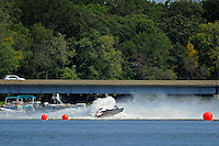 Frame 2: Dan Orchard, (#97) spins and rolls over in the East Turn. (SST-120 class)