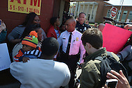 Baltimore, MD - April 25, 2015: Baltimore City police commissioner Anthony Batts, center, talks to people gathered near the Baltimore Police Department's Western District Headquarters, April 25, 2015, as protestors gathered to demand police accountability in the death of Freddie Gray and protest police brutality. Gray died of a broken spine while in police custody.  (Photo by Don Baxter/Media Images International)