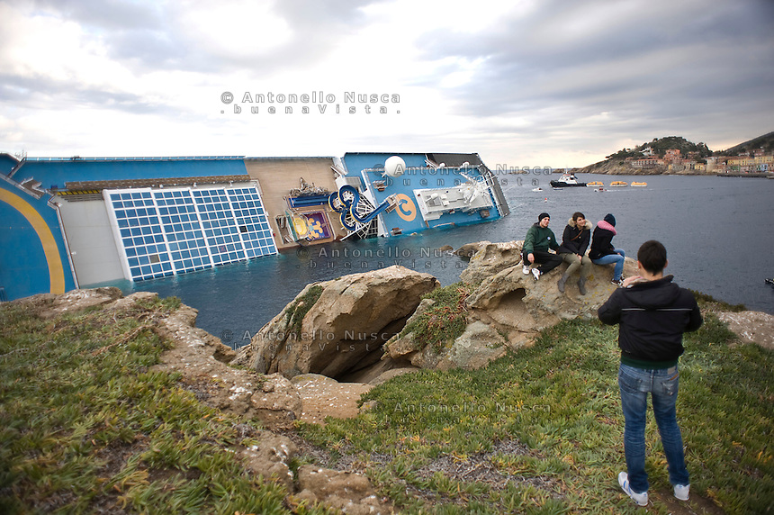 Island of Giglio, Italy, January 15, 2012.  Isola del Giglio citizens looks at the Costa Concordia in the harbor of the Tuscan island of Giglio after it ran aground after hitting underwater rocks.