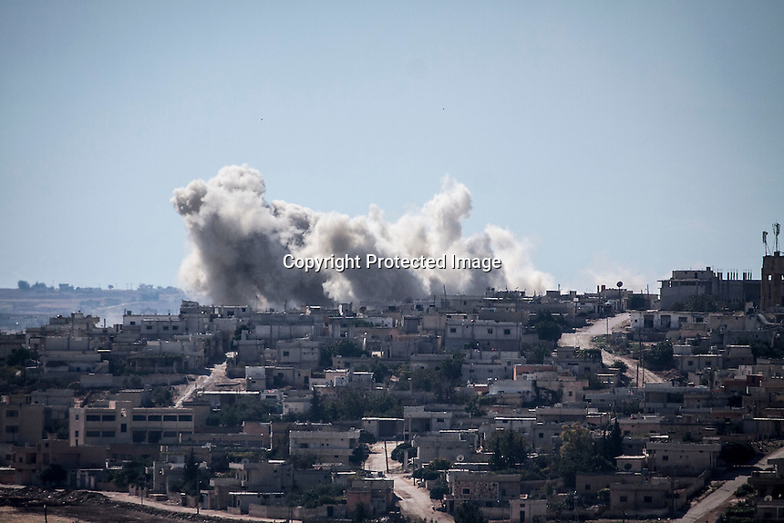 In this Wednesday, Sep. 25, 2013 photo, smoke rises from buildings from an airstrike that hit Habit village, in the Syrian central province of Hama. (AP Photo)