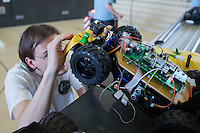 Competitor adjusts his car during the RobonAut technical university race for self driving autonomous cars in Budapest, Hungary on January 10, 2015. ATTILA VOLGYI