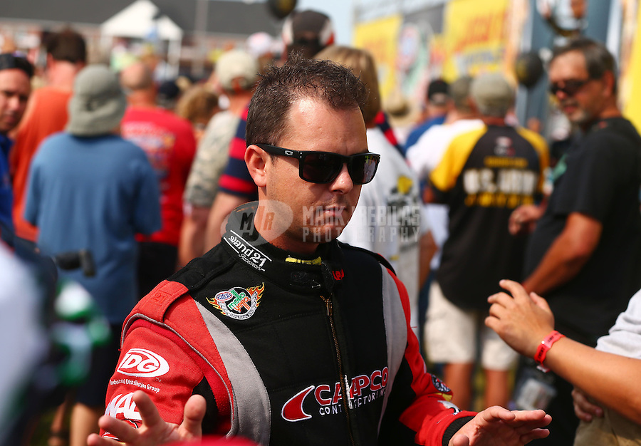 Aug. 18, 2013; Brainerd, MN, USA: NHRA top fuel dragster driver Steve Torrence during the Lucas Oil Nationals at Brainerd International Raceway. Mandatory Credit: Mark J. Rebilas-