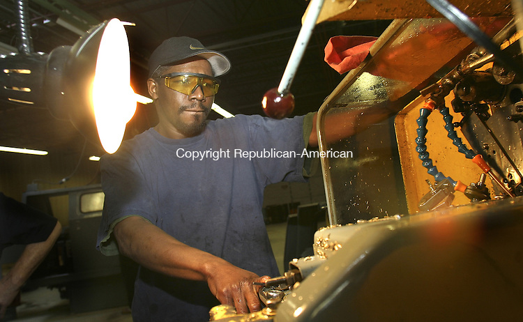 WATERBURY, CT. 14 MARCH  2005--031405SV04--Reggie Griffin of Waterbury  works on a Brown and Shape machine at the Waterbury Tech. Center in Waterbury Monday. The center,  which trains people on manufacturing equipment, is moving to a new building on Interstate Lane in Waterbury. Steven Valenti Photo<br />