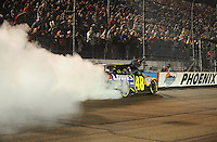 Nov. 9, 2008; Avondale, AZ, USA; NASCAR Sprint Cup Series driver Jimmie Johnson celebrates after winning the Checker Auto Parts 500 at Phoenix International Raceway. Mandatory Credit: Mark J. Rebilas-