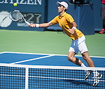 Novak Djokovic (SRB) splits the first two sets against Alexandr Dolgopolov (UKR) 4-6, 7-6at the Western and Southern Open in Mason, OH on August 22, 2015.