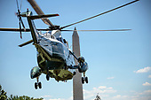 Very hight resolution view of Marine One, with United States President Donald J. Trump and first lady Melania Trump aboard, departs the White House in Washington, DC en route to Joint Base Andrews where they will pay their respects to the family of fallen United States Secret Service Special Agent Nole Edward Remagen who suffered a stroke while on duty in Scotland on Wednesday, July 18, 2018.<br /> Credit: Ron Sachs / CNP