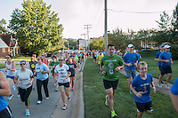 More than 200 runners are all smiles just after the start of the Run with Meb Keflezghi event hosted by Fleet Feet St. Louis in Des Peres, MO. Wednesday, September 3, 2014.