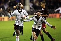 Moussa Dembele of Fulham scores and celebrates his third goal