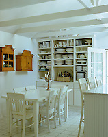 In this contemporary take on a country kitchen a custom-built dresser houses the owner's collection of plates and crockery