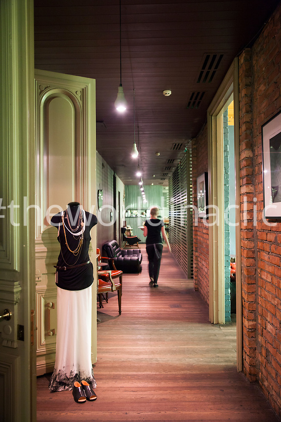 RUSSIA, Moscow. Interior hallway at Solyanka Club with entrance to Twins Shopp Clothing store.