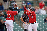 Rochester Red Wings Tomas Telis (18) high fives Jordany Valdespin (23) after hitting a home run during an International League game against the Charlotte Knights on June 16, 2019 at Frontier Field in Rochester, New York.  Rochester defeated Charlotte 11-5 in the first game of a doubleheader that was a continuation of a game postponed the day prior due to inclement weather.  (Mike Janes/Four Seam Images)