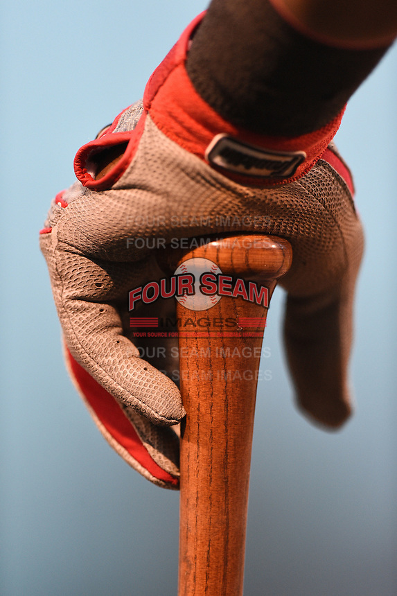 Indianapolis Indians outfielder Mel Rojas (3) hand on top of his bat in the dugout during a game against the Rochester Red Wings on July 26, 2014 at Frontier Field in Rochester, New  York.  Rochester defeated Indianapolis 1-0.  (Mike Janes/Four Seam Images)