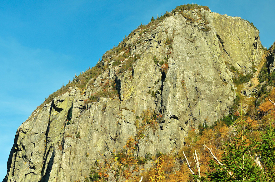 A close up look at Eagle Cliff in Franconia Notch. It looks impressive from the road, it's quite massive up close. On occasion you may see colorfully dressed rock or ice climbers clinging to crumbling rock or threads of ice.