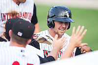 Trey Michalczewski (27) of the Kannapolis Intimidators is congratulated by teammates after hitting a home run against the Savannah Sand Gnats at CMC-Northeast Stadium on June 9, 2014 in Kannapolis, North Carolina.  The Intimidators defeated the Sand Gnats 4-2.  (Brian Westerholt/Four Seam Images)