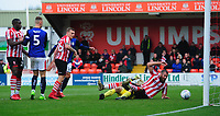 Lincoln City's Harry Anderson, left, has a goal ruled out after Crewe Alexandra's Ben Garratt had challenged Lincoln City's Michael Bostwick for the ball<br /> <br /> Photographer Chris Vaughan/CameraSport<br /> <br /> The EFL Sky Bet League Two - Lincoln City v Crewe Alexandra - Saturday 6th October 2018 - Sincil Bank - Lincoln<br /> <br /> World Copyright &copy; 2018 CameraSport. All rights reserved. 43 Linden Ave. Countesthorpe. Leicester. England. LE8 5PG - Tel: +44 (0) 116 277 4147 - admin@camerasport.com - www.camerasport.com