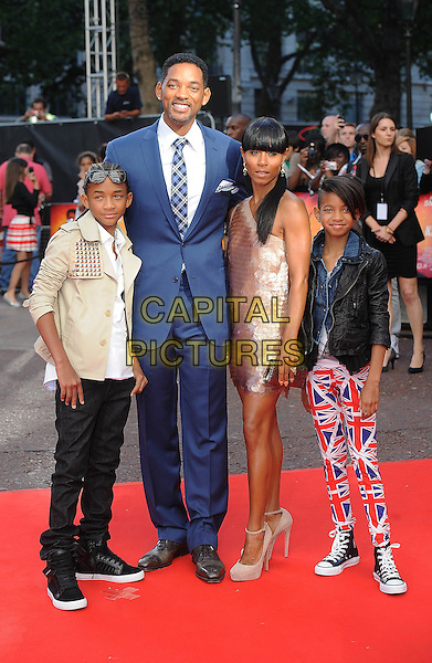 "JADEN SMITH, WILL SMITH, JADA PINKETT SMITH & WILLOW SMITH .The Gala Premiere of ""The Karate Kid"", Odeon Leicester Square, London, England, UK..15th July 2010.full length beige suit top jacket shirt white t-shirt studs studded leather black pink paillettes discs dress one shoulder shiny sunglasses shades family parents kids children mom mum dad mother  father sister siblings married husband wife blue suit tie checked check plaid tartan union jack flag print pants trousers converse trainers .CAP/BEL.©Tom Belcher/Capital Pictures."
