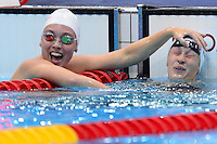 PICTURE BY ALEX BROADWAY /SWPIX.COM - 2012 London Paralympic Games - Day One - Swimming - Aquatics Centre, Olympic Park, London, England - 30/08/12 - Summer Ahsley Mortimer of Canada & Sophie Pascoe of New Zealand react after the Women's 100m Individual Medley SM10 Final.