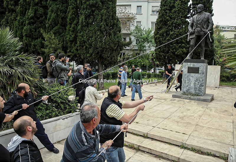 Pictured: Protesters attempt to bring down the statue of Harry S. Truman in Vassileos Georgiou Street in central Athens, Greece. Monday 16 April 2018<br /> Re: Clashes broke out between protesters and the police when members of the Greek Communist Party (KKE) attempted to vandalise the statue of former US President Harry S. Truman, during a protest against the bombing of Syria by the US and its allies.